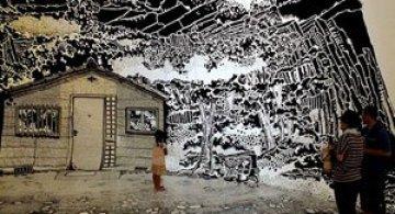 Oscar Oiwa a desenat o insula pe peretii unei scoli