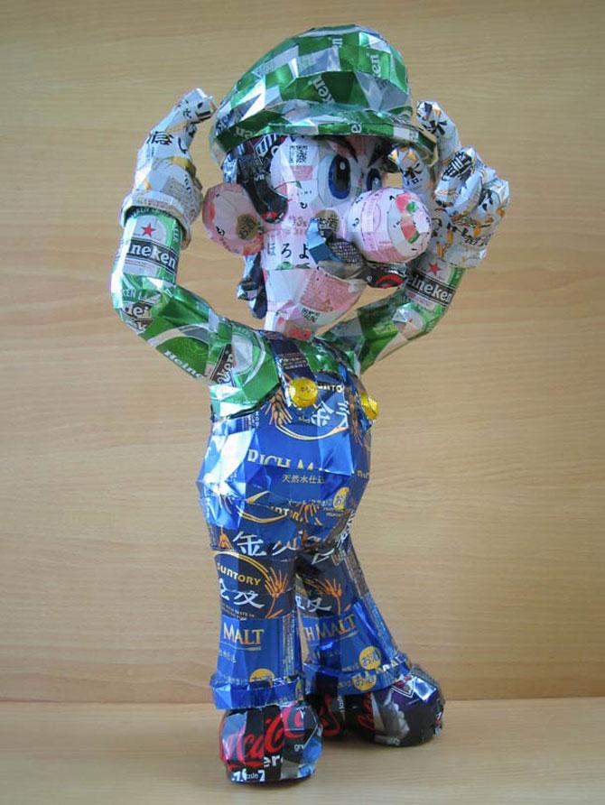 10 sculpturi din doze reciclate de bauturi - Poza 9