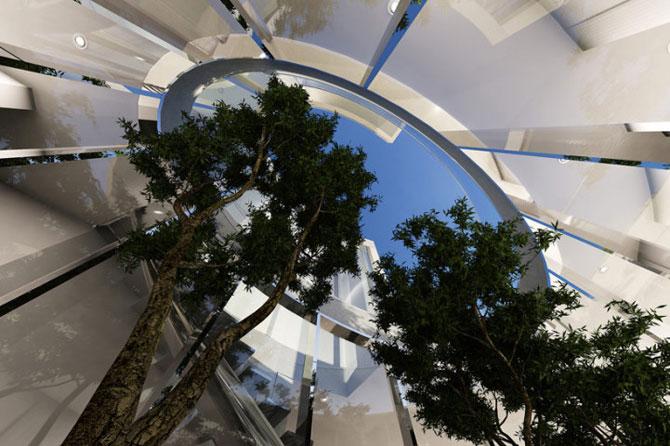 Casa ovala, cu copaci vii, pe malul oceanului - Poza 9