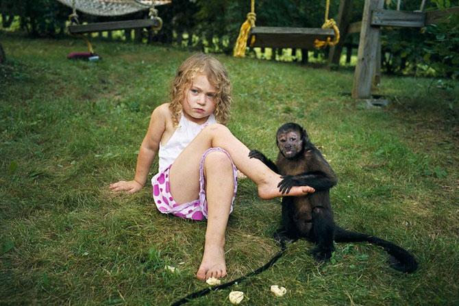 28 de super poze cu fetita care iubeste toate animalele - Poza 4