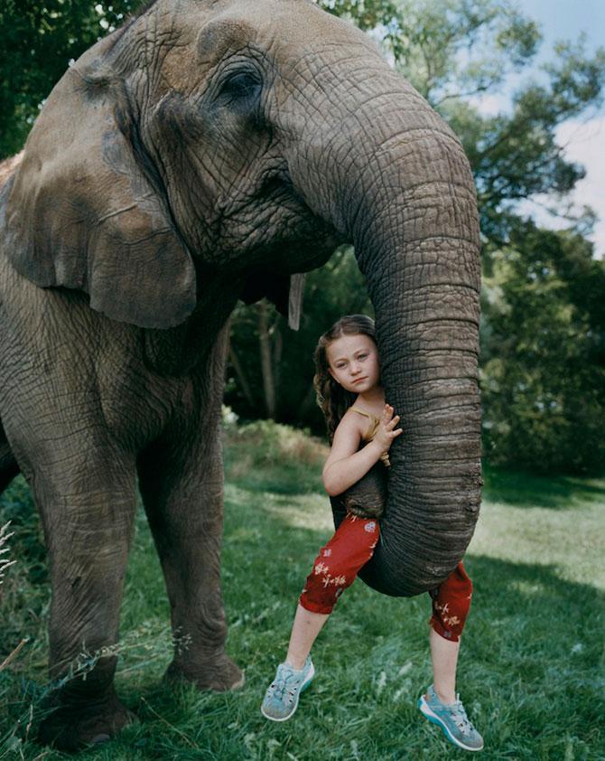 28 de super poze cu fetita care iubeste toate animalele - Poza 6