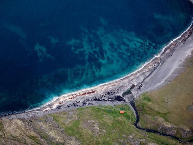 Peisaje islandeze fotografiate din varf de aripa - Poza 11