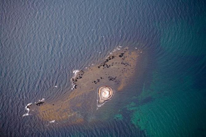 Peisaje islandeze fotografiate din varf de aripa - Poza 12