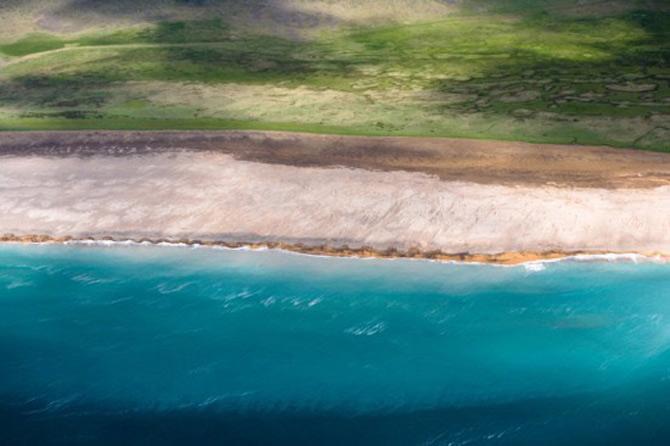 Peisaje islandeze fotografiate din varf de aripa - Poza 13