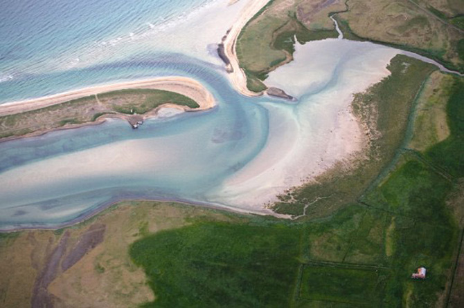Peisaje islandeze fotografiate din varf de aripa - Poza 14
