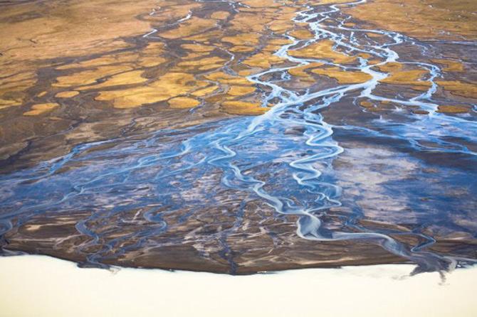 Peisaje islandeze fotografiate din varf de aripa - Poza 16