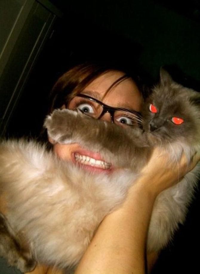 Pe jumatate om, pe jumatate pisica - Poza 9