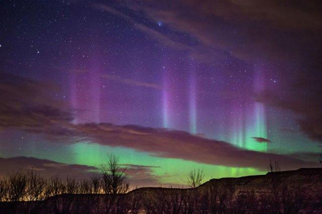 Lumini nordice dansand pe cerul instelat - Poza 10